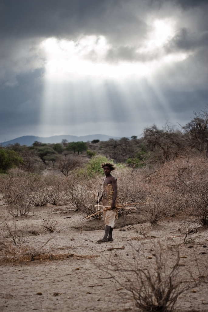 An amazing shot of this young man as he goes on his daily hunt. Photo by Andrew Knapp Boma Africa