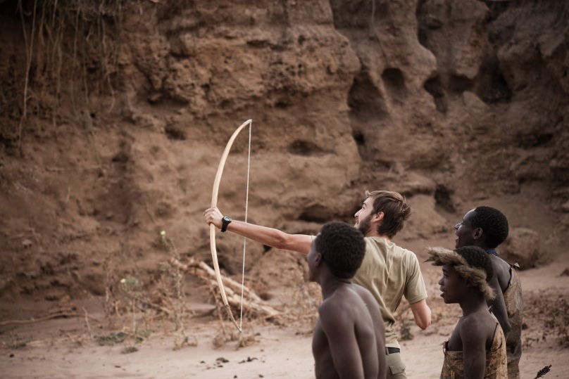 The Hadzabe take Glen out for shooting practice with their home made bows and arrows Photo by Andrew Knapp Boma Africa