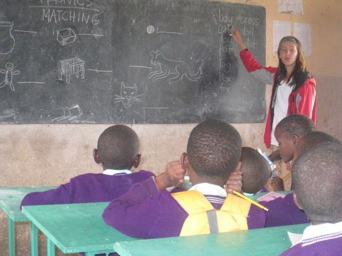 Boma Africa volunteer teaches English at a local school.